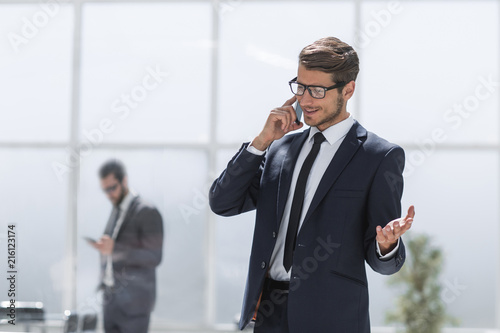 confident businessman talking on a mobile phone.