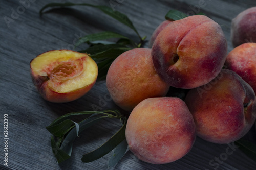 homemade ripe juicy peaches on a wooden table