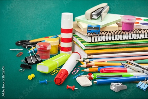 Colorful school supplies on wooden table