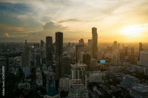 In de dag Bangkok Modern building in Bangkok business district at Bangkok city with skyline during sunset, Thailand.