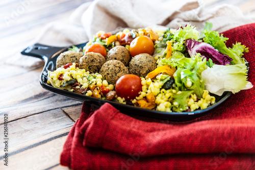 Salad with semolina, Falafels Pickled vegetables and raisins Sauce