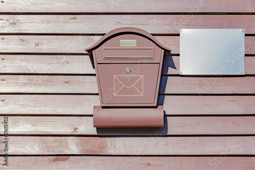 Mail box on the wooden fence.