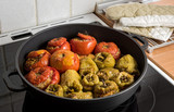 Stuffed tomatoes and peppers in cooking pot, a traditional recipe in Greece and other mediterranean countries