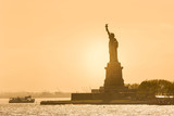 Statue of Liberty silhouette in sunset, New York City, USA. - 216170563