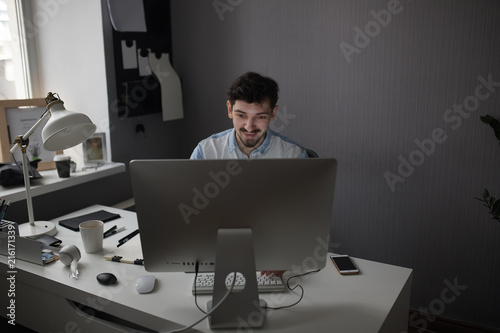 Sticker Young intelligent bearded man working at modern loft studio-offi