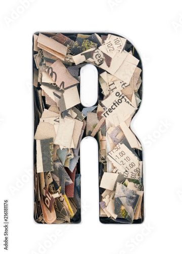 Foto Murales financial news  newspaper cut up into confetti  to make  the captal letter