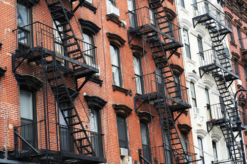 Facades of the buildings in new York city with cast-iron staircases