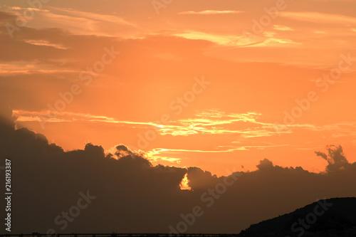 Canvas Oranje eclat Sunset ,in the sea water the beautiful sky