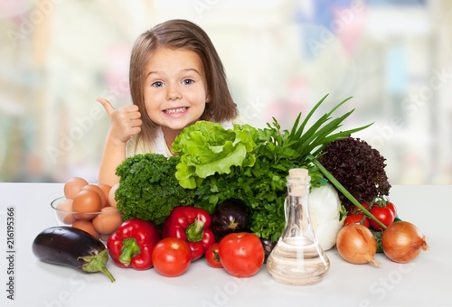 Portrait of adorable little girl preparing healthy food - 216195366