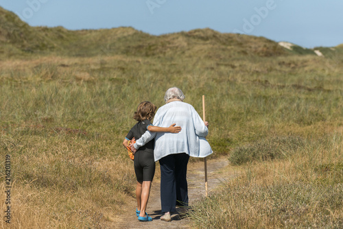Grandchild Supports Grandma when Walking