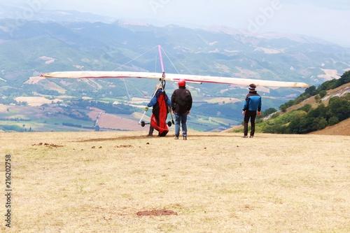 Fotobehang Beige Ala delta en vuelo