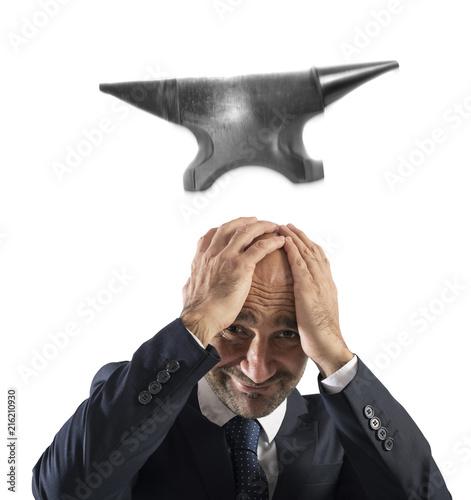 Leinwandbild Motiv Difficult career in business with falling anvil