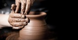Hands of potter making clay pot - 216232980