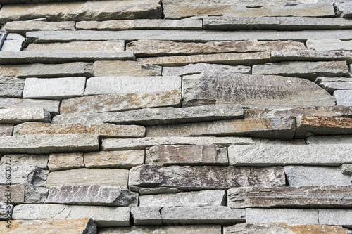 Decorative stones on the wall. - 216233737