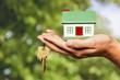 Leinwanddruck Bild - Businessman Holding House Model and Keys