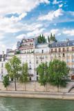 Paris, view of ile saint-louis and quai de Bethune, beautiful buildings with a terrace on the roof
