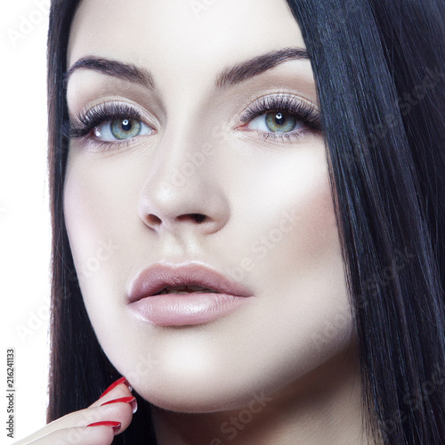 Beauty face of young caucasian model woman with natural nude makeup and hand near clean skin. Skincare facial treatment concept. White background