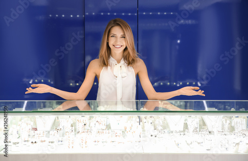Young shop assistant in jewelry store
