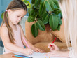kids artistic leisure. painting art hobby. little girl and her mom drawing pictures with pencils.
