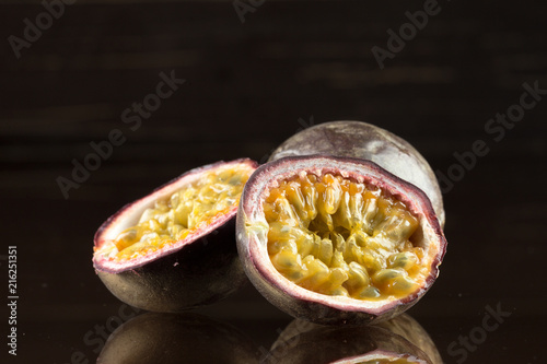 Foto Murales yellow passion fruit on wood background