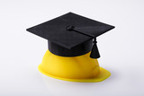 Close-up Of Graduation Hat On Yellow Hardhat - 216251796