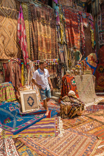 Young Man Tourist At An Old Traditional Turkish Carpet Shop In Cave House Cappadocia Turkey