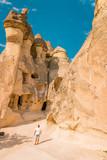 happy young couple on vacation in Turkey Cappadocia, Rock Formations in Pasabag Monks Valley, Cappadocia, Turkey