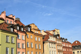 Old medieval colorful houses with beautiful decorations in Warsaw old town, Poland
