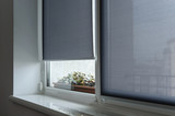 Gray roller shutters on the window.