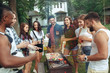 Leinwanddruck Bild - Group of friends making barbecue in the backyard. concept about good and positive mood with friends