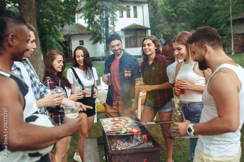Group of friends making barbecue in the backyard. concept about good and positive mood with friends - 216275787