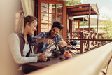 Couple on holiday having coffee in morning