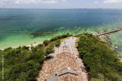 Foto Spatwand Olijf Aerial image of Ilha dos Frades in All Saints Island Bahia Brazil