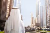 Man Standing In Front Of Dubai Cityscape