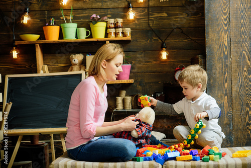 Playschool concept. Playschool kid play with mother. Playschool activities. Playschool education and child care