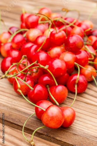 Foto Spatwand Kersen Pile of cherries on wooden background. Close up.