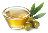 Bowl of olive oil and green olives with leaves - 216296159