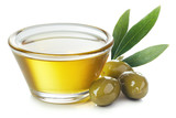 Bowl of olive oil and green olives with leaves - 216296180