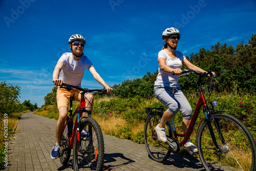Healthy lifestyle - people riding bicycles  - 216302559