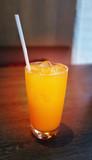 Photo of a close-up of a bright orange juice