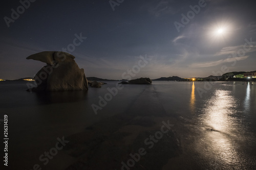 Fotobehang Zee zonsondergang Luce della luna