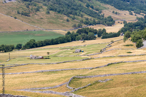 Fotobehang Beige CONISTONE, YORKSHIRE/UK - JULY 27 : View of a farm near Conistone in Yorkshire on July 27, 2018