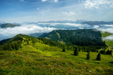 A Long View of the Alpine Meadows and the Valley in the Light Inverse Cloud