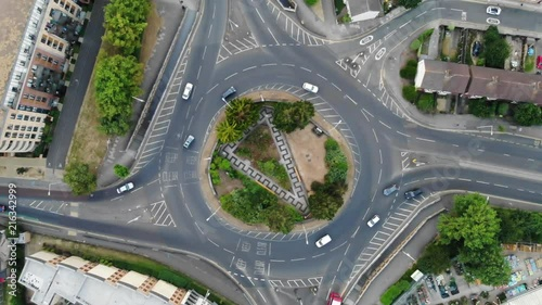 Overhead aerial view of the circular shaped roundabout with the camera slowly moving towards the center of the roundabout in Romford, Havering, London, England, Europe