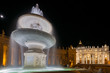 Quadro Night shot of Bernini's fountain and the Basilica at St Peter's piazza in Rome