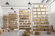 Leinwandbild Motiv Warehouse shelves with cartboard boxes front view