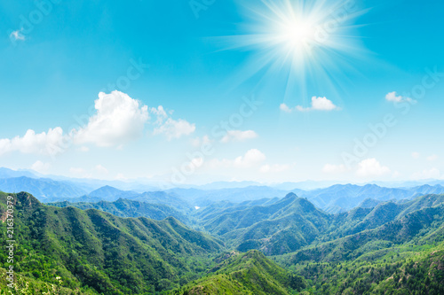 Green mountains and beautiful sky under the blue sky - 216370379
