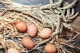 Egg. Fresh farm eggs on a wooden rustic background - 216371141