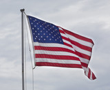 American flag moving in the wind - 216390152