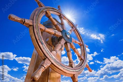 Canvas Zeilen steering wheel against a sunny blue sky